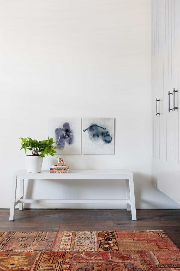 Wall-mounted wardrobes have been lifted above the floor creating a roomier feel.