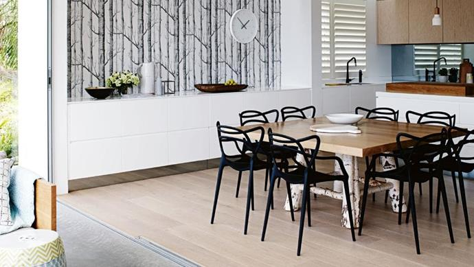 Inspired natural elements blend with sophisticated Scandi appeal to create a relaxed entertaining space. A wall in [Cole & Son](http://www.cole-and-son.com) monochromatic 'New Contemporary Two Woods' wallpaper echoes the [Mark Tuckey](http://www.marktuckey.com.au) table, the shapely Kartell 'Masters' dining chairs and the European oak flooring Photographer: Prue Ruscoe