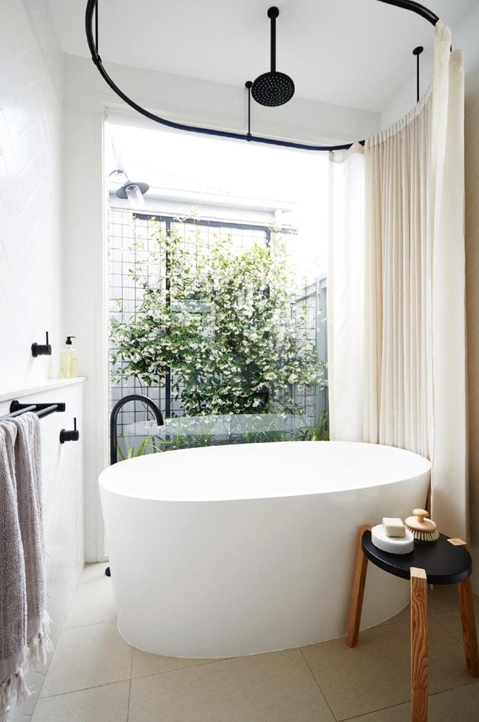 **Oasis of calm**. If you're all about the bath, then position it perfectly to give your daily ritual the respect it deserves. Freestanding models feel infinitely more special, and shape is key. If you have space, go for one you can stretch out in, but if size is an issue (for the bathroom, not you), go for something deep so you can still soak up to your chin. Designed by [Bloom Interior Design & Decoration](http://bloominteriordesign.com.au/). Built by [BM Building Solutions](http://www.bmbuildingsolutions.com.au/) Stylist: Heather Nette King, Photographer: Armelle Habib