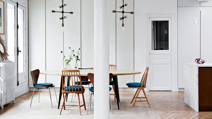 """A wall of floor-to-ceiling cabinetry in the kitchen keep this [Parisian apartment](https://www.homestolove.com.au/a-family-of-six-makes-clever-use-of-storage-in-a-parisian-apartment-15490