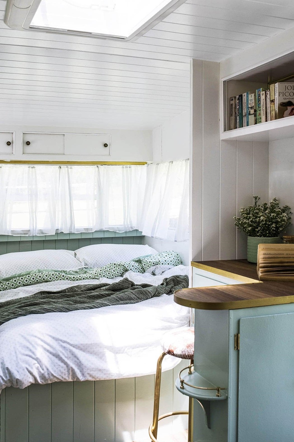 """<p>**TO CREATE THE ILLUSION OF SCALE IN SMALL SPACES**<p> <p>In a tiny space, there really isn't much wall space to work with. Adding a series of artworks could close the space in, while beautifully styled shelving just isn't practical. This [vintage caravan](https://www.homestolove.com.au/inside-michael-and-carlenes-holiday-home-transformation-18527