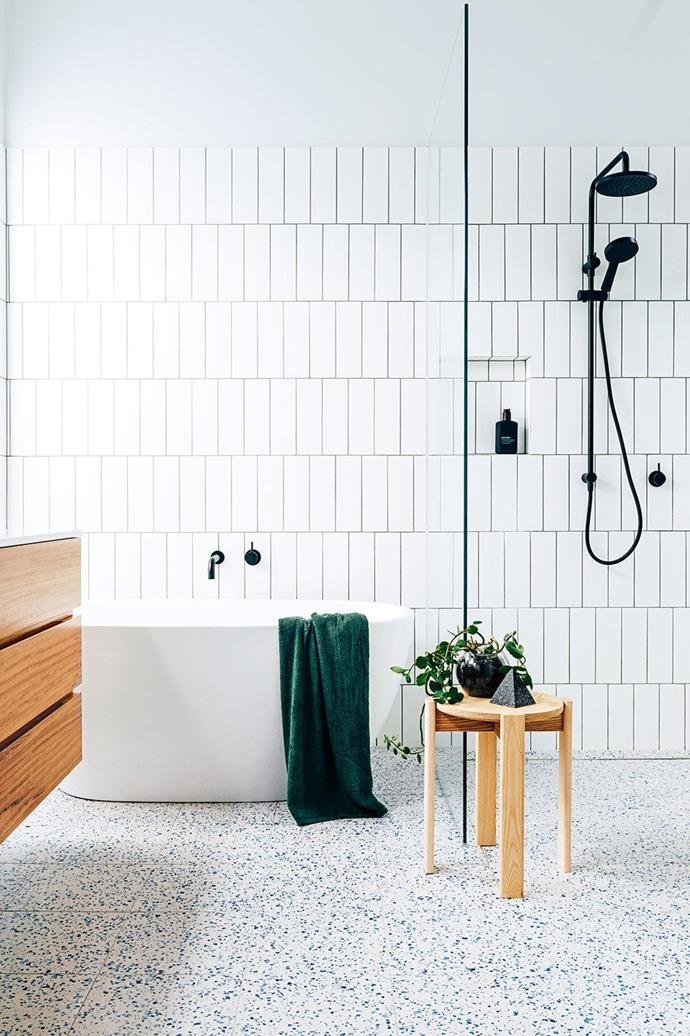 Terrazzo tiles combined with timber makes for a fun and vibrant interpretation of the ever-popular all-white bathroom.