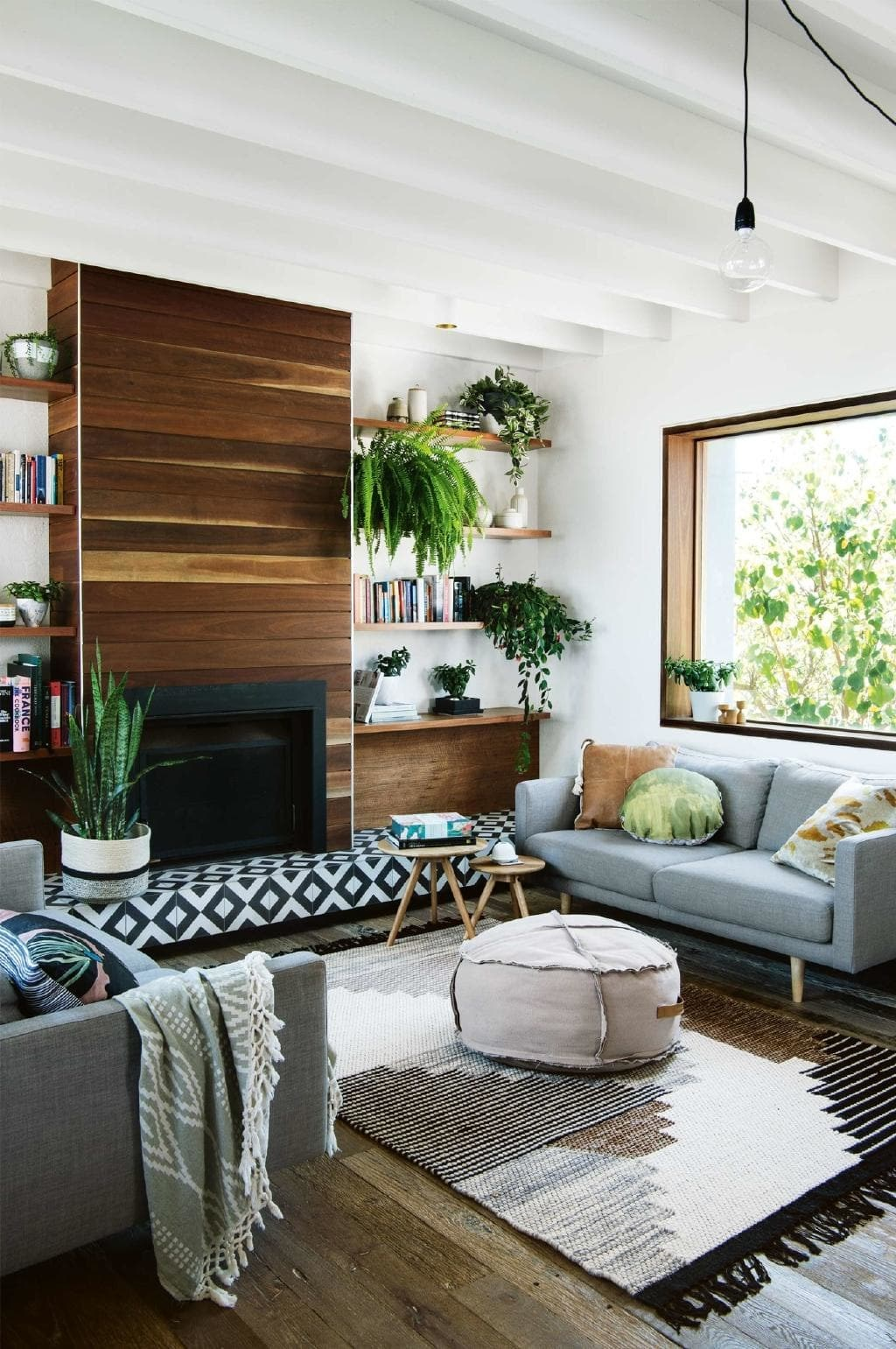 """<P>**TO ANCHOR A FIREPLACE**<P> <P>Installing a new fireplace in an existing home can result in a pair of awkward spaces on either side of the chimney. In this [textured, coastal home](https://www.homestolove.com.au/how-to-bring-coastal-textures-into-the-home-18270