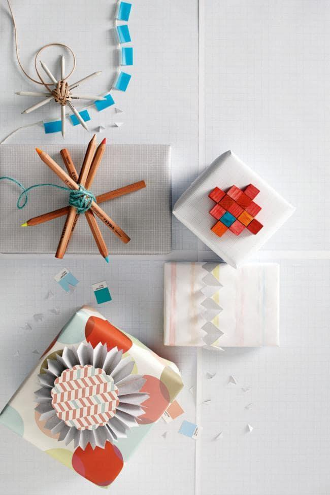 Make a pencil starburst topper that doubles as a gift. Stack pencils on top of each other, rotating each one until a nice shape is created. Secure in place by wrapping cord around the centre repeatedly until it's fixed in place Photographer: Guy Bailey