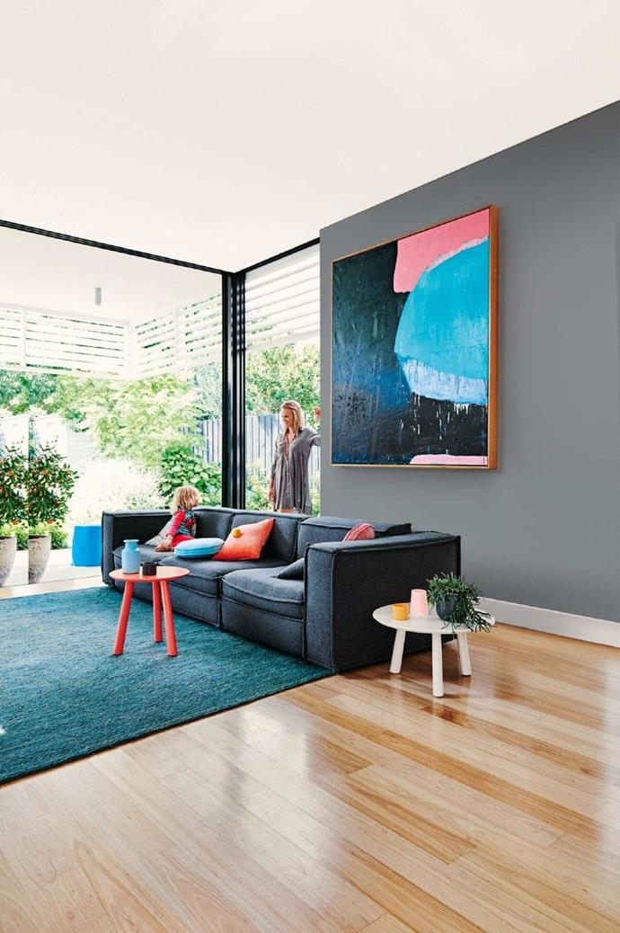Let your art inform the rest of your style – including your colour palette. Here, a bold piece by [Andrew O'Brien](http://www.andrewobrienartist.com/) plays a starring role Stylist: Heather Nette King, Photographer: Lisa Cohen