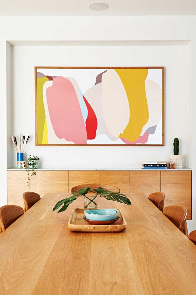 **HANG A LARGE FRAMED ARTWORK**<br><br>A beautiful print or painting has the power to transform a space from so-so to stunning. In this example a [Ubabub Sundae](http://ubabub.bigcartel.com/product/sundae) framed print not only adds energy to the space it acts as a focal point at the end of the dining table<br><br>