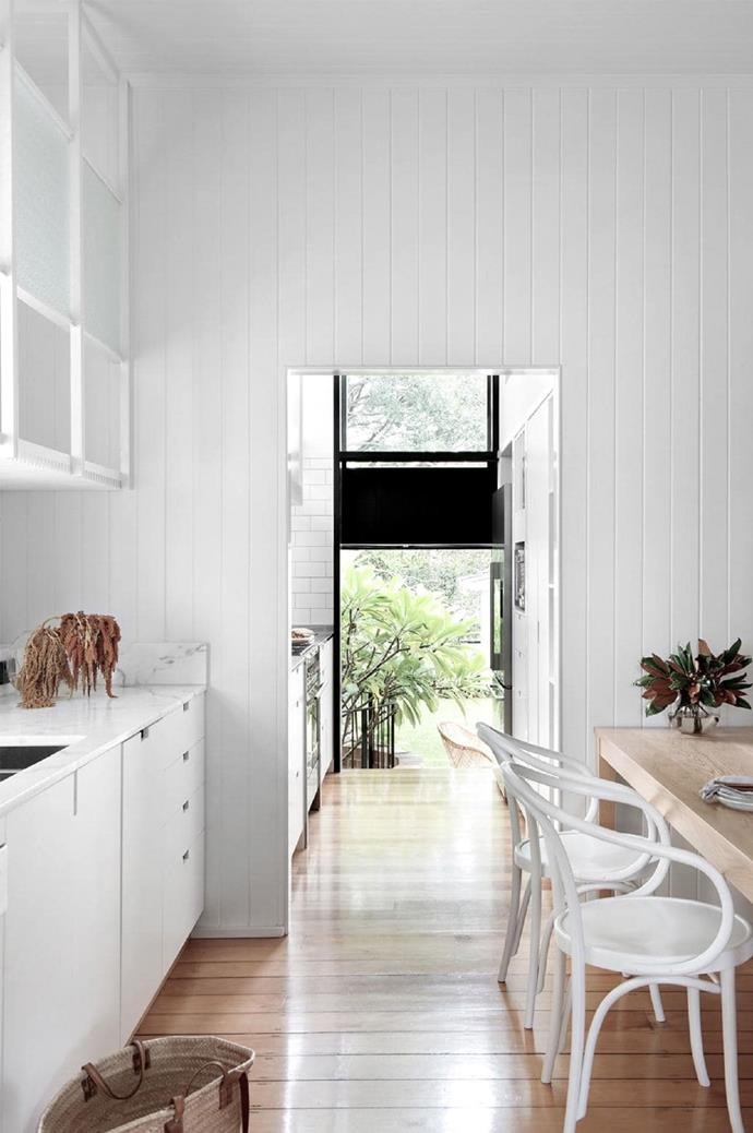 Oiled-timber floors are a real design feature of this house, forming the organic feel from the ground up. Aaron Peters's sympathetic alteration makes this house a showstopper! The black detailing in the doors add a contemporary look to the space.
