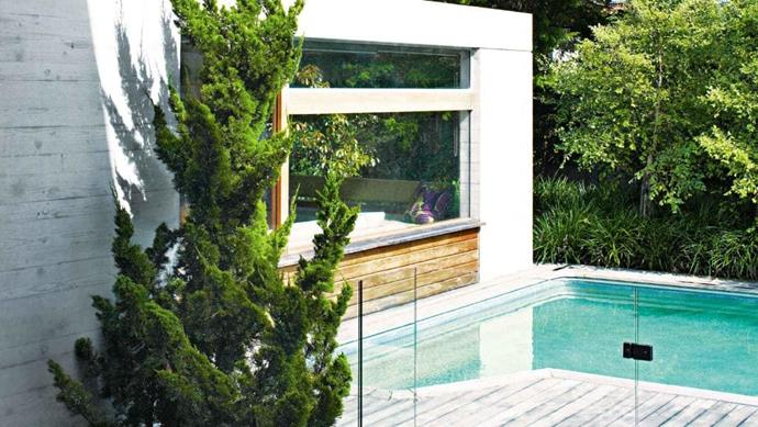 The large window provides uninterrupted views of the pool and garden while letting an abundance of light into the living area Stylist: Karen Cotton, Photographer: Prue Ruscoe