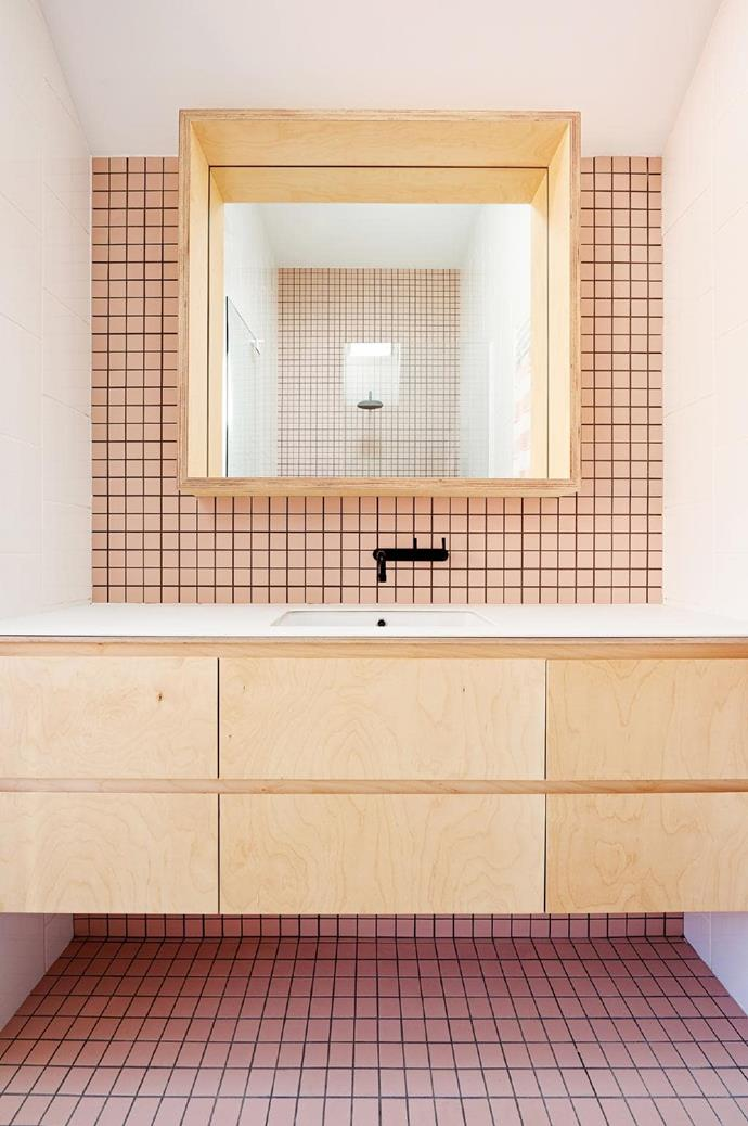**Hip to be square**. There are so many elements to love in this Scandi-inspired bathroom: the pale plywood cabinetry, the interesting mirror frame detail, the single black punctuation point and the perfect pale pink. And can we talk about square tiles? They're a great alternative to subway and make a graphic statement, especially with a dark grout colour. Designed by [Dan Gayfer Design](https://dangayfer.com/) Photographer: Dean Bradley
