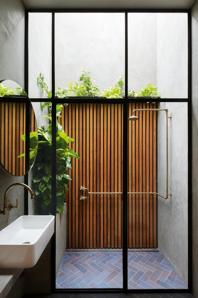 **Urban escape**. Outside showers don't have to be limited to beach or bush locations – if you have a light well, you have an opportunity. The finishes, timber slats, herringbone bricks, concrete and copper strike just the right balance between rustic and refined. Top marks for healthy and lush greenery. Designed by [Breathe Architecture](http://www.breathe.com.au/) Photographer: Katherine Lu
