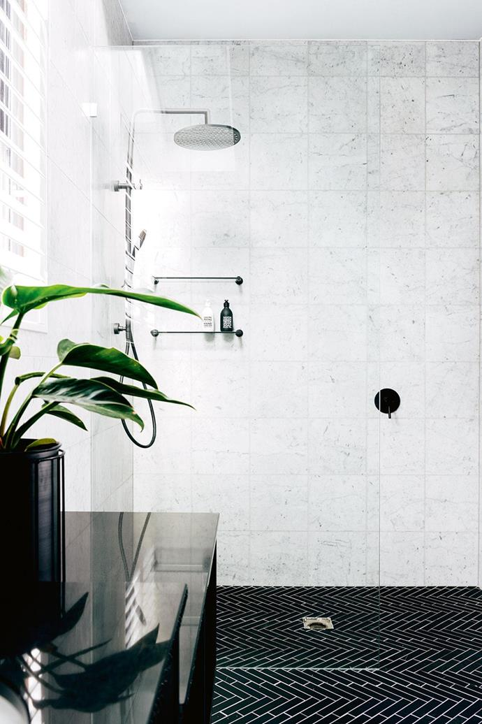 "A simple colour palette allows the [feature bathroom tiles](https://www.homestolove.com.au/bathroom-tile-ideas-5447|target=""_blank"") in this space to shine."
