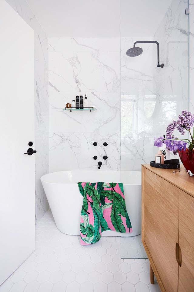 "Looking at this bathroom alone, you'd never believe the rest of the [house is bursting with wild, colourful wallpaper](https://www.homestolove.com.au/this-sorrento-beach-shack-is-given-a-wild-makeover-16528|target=""_blank"") in a bohemian style. In this room, the owners have opted for a calming, classic white which makes the room a relaxing sanctuary."