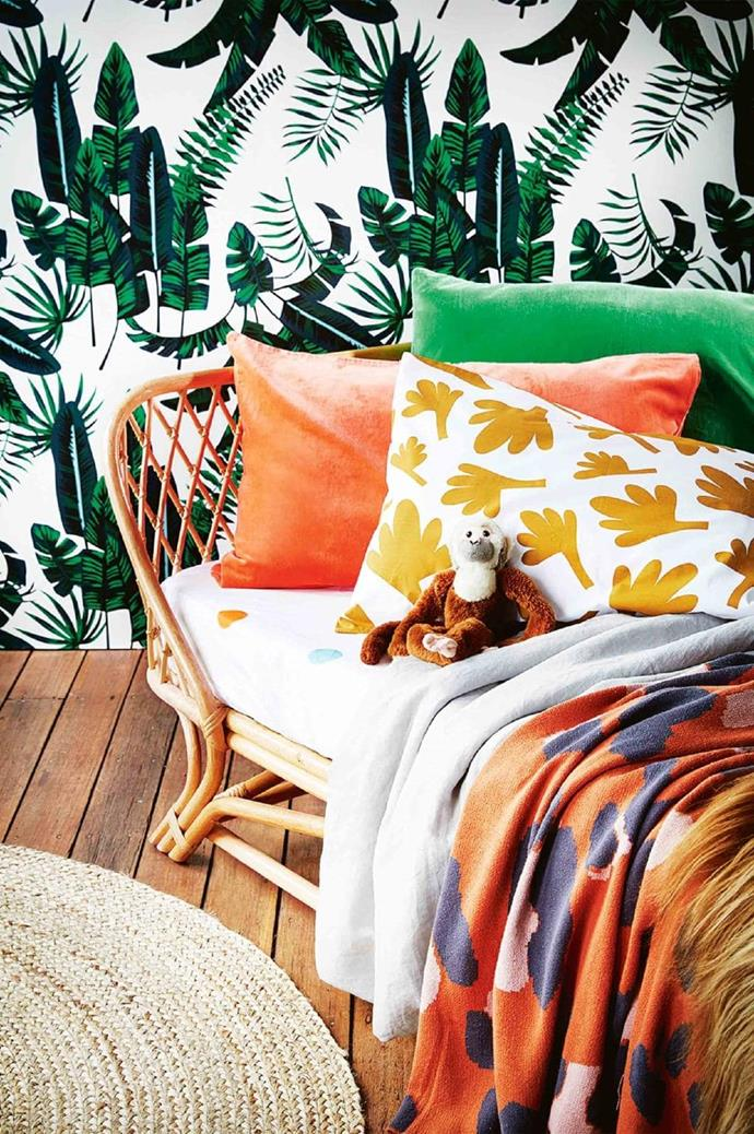 The rattan bed is the perfect centrepiece for this bedroom straight out of The Jungle Book. It's also a great option for toddlers transitioning from a cot to a bed as it sits low to the ground. 'London' daybed, $799, [Byron Bay Hanging Chairs](http://byronbayhangingchairs.com.au/) Stylist: Julia Green, Photographer: Armelle Habib