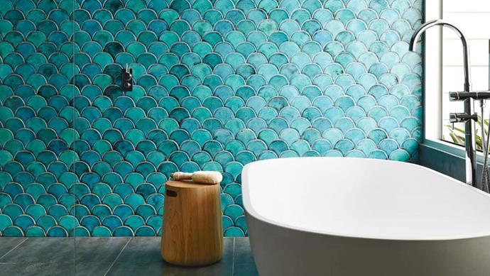 Simple and stylish design choices from the bath tub, floor tiles and glass shower screen ensure that the handmade wall tiles are the hero feature of the bathroom Photographer: Anson Smart, Stylist: Maria Dyoniziak