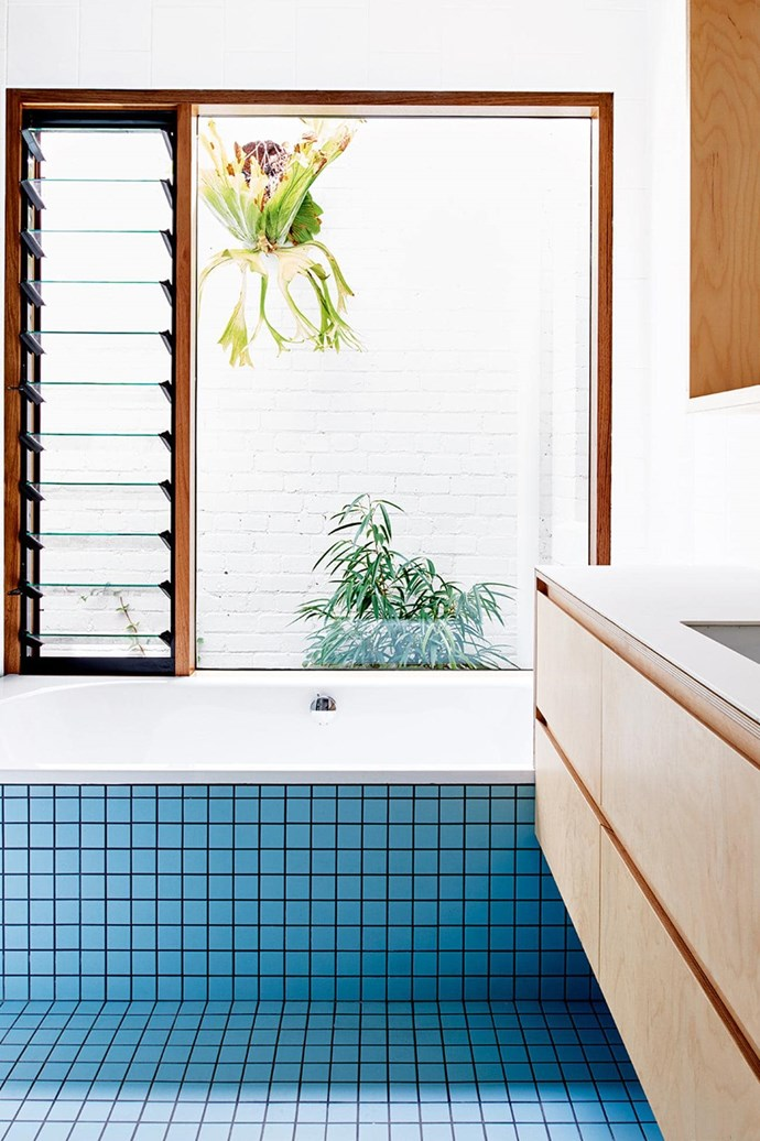 """The blue tiles give an [80's flair](https://www.homestolove.com.au/tour-a-melbourne-home-with-modernist-appeal-and-80s-flair-16157