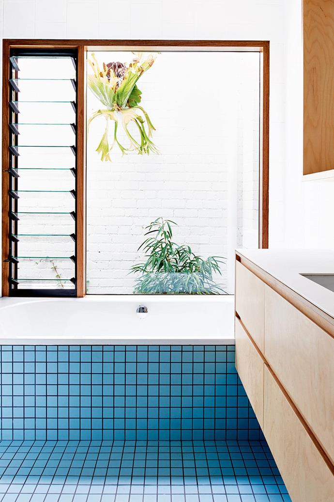 "The blue tiles give an [80's flair](https://www.homestolove.com.au/tour-a-melbourne-home-with-modernist-appeal-and-80s-flair-16157|target=""_blank"") to this bathroom and are lit up by a skylight overhead."