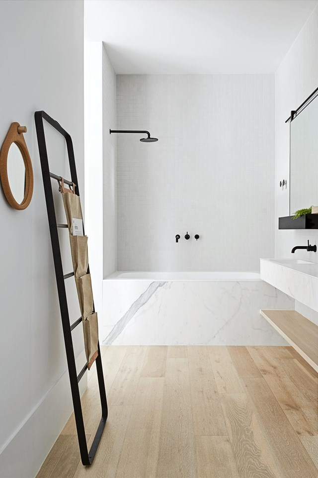 "Engineered oak flooring makes for a [considered bathroom](https://www.homestolove.com.au/get-the-look-this-bathroom-is-made-of-pale-tones-and-considered-details-16144|target=""_blank"") that connects seamlessly with the rest of the home. Black fixtures and fittings add to the room's contemporary appeal."