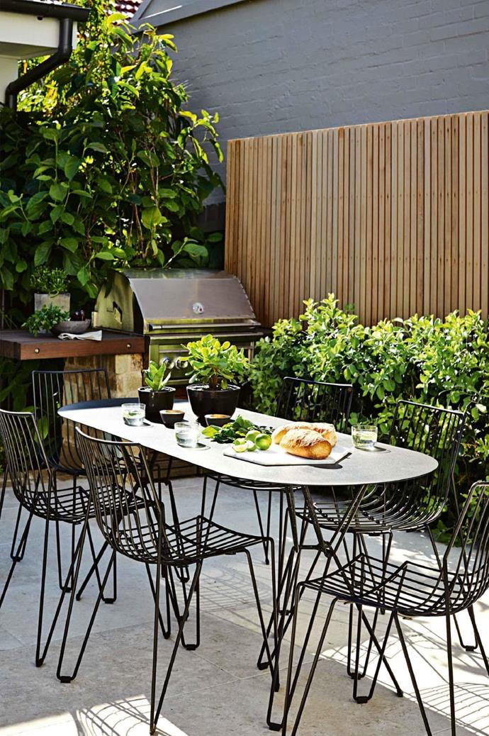"The barbecue was built into a base that suited both home and garden. ""By building in the barbecue with a timber shelf and stone wall to match the house, we have made a small area very functional,"" says designer Mike Cass of [Design-It Landscapes](http://www.designitlandscapes.com.au/) Photographer: Natalie Hunfalvay, Stylist: Adam Robinson"