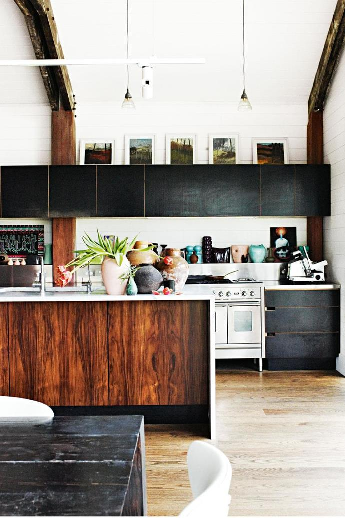 Mixing timber with black cupboards give this kitchen a warehouse edge. Adding greenery and colourful vessels helps to give it a more homely feel
