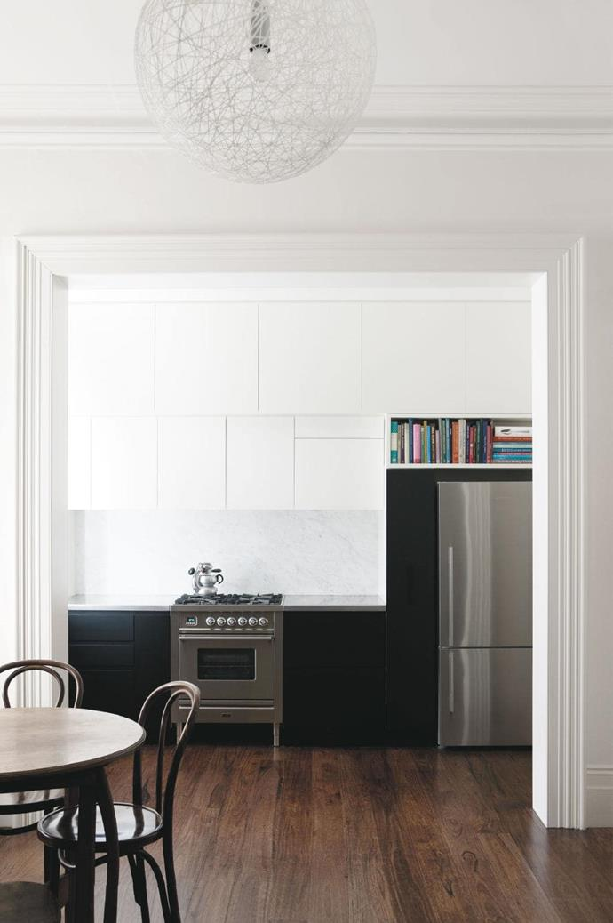 The high cabinetry in white almost disappears into the background making this kitchen feel bigger and extending them up to the ceiling provides ample storage.