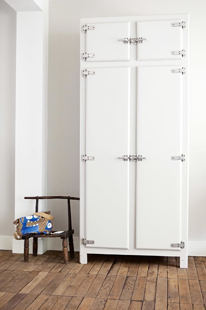 Extra tip: Make a stand. Built-in storage has its virtues but feature storage also has its place. This locker-style cabinet matches the home's industrial-meets-white look Stylist: Jessica Bouvy, Photographer: Dana Van Leeuwen
