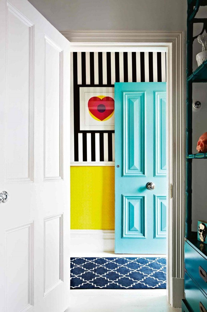 The entry into this home hints at the bright and bold style within. A Tiffany's bag was the colour inspiration for the aqua painted door.