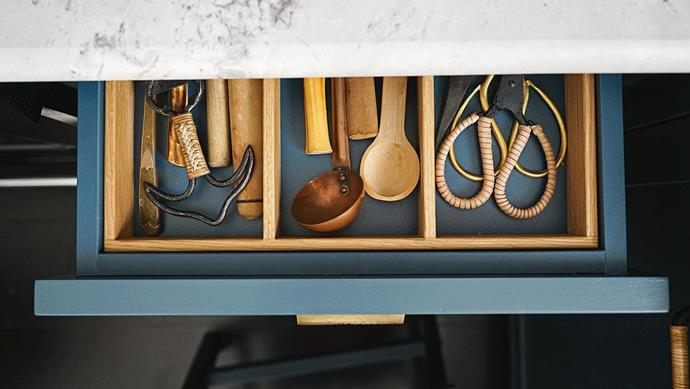 "**DRAWER DETAILS** <br><br>When stylist and author [Sibella Court](https://www.homestolove.com.au/step-inside-interior-designer-sibella-courts-charming-apartment-17433|target=""_blank"") designed her own kitchen, she incorporated cabinetry with her favourite indigo, Boro 2 from her own paint range with Murobond Paints. But instead of basic white melamine drawer inners, she chose Laminex in Deep Sea to match and finished the look with solid oak dividers. ""Now the drawer makes me happy every time I open it,"" says Sibella.<br><br>"
