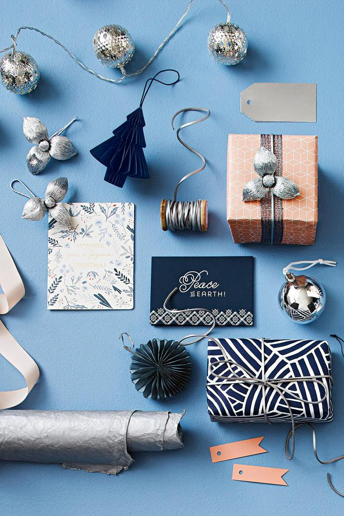<b>Navy, peach &amp; silver</b> Team midnight blue with soft coral for contrast and finish it off with pearlescent gunmetal.  <b>Products</b> 'Heliad' string lights, $19.95, Freedom. Papetal handmade paper flowers with hook in Silver, $4.95 each, Paper2. Nordstjerne 'Tree' paper ornament in Midnight Blue, $15, Nordic Rooms. House Doctor leather ribbon in Silver, $9.95/5m roll, Milligram. Metallic silver tags, $9.95/pack of 10, Inky Co. 'Aria' ribbon in Navy, Vandoros. 'Peach Cubes/Blue Floral' double-sided gift wrap, $5.95/sheet, Bespoke Letterpress. Silver ornament, stylist's own. Bison Letterpress 'Peace On Earth' greeting card, $7.95, and 'Japanese Wave' wrapping paper in Blue/White, $3/metre, Paper2. 'M&aring;ngfald' gift tags, $1.99/assorted set of 22, IKEA. Textured silver wrapping paper, Vandoros. Mini paper fan in Grey, $35/assorted set of 3, Papier D'Amour. Ribbed peach ribbon, Vandoros. '12 Days Of Christmas Wishing You A Joyous Christmas' Christmas card, $7.95, Bespoke Letterpress.