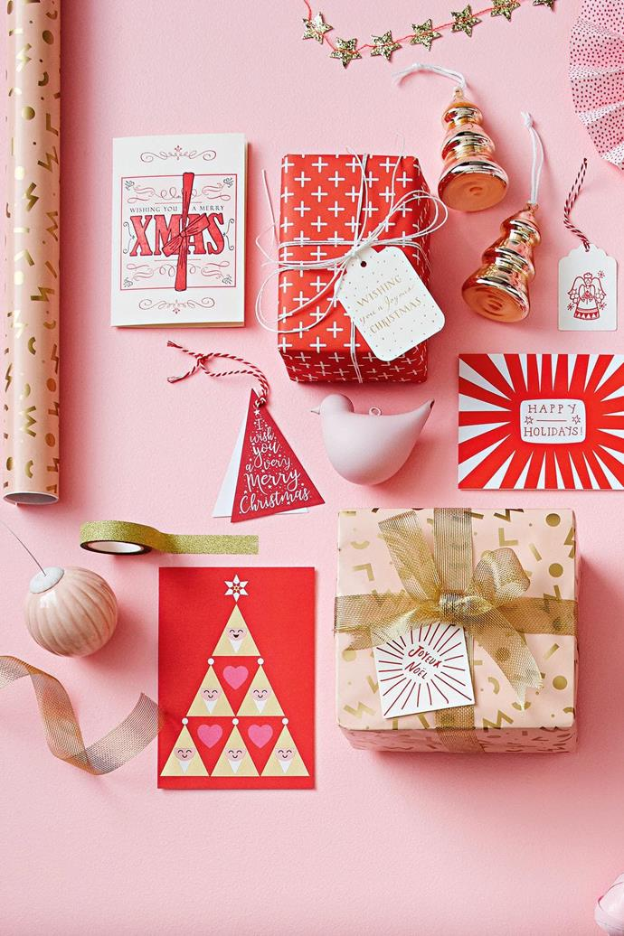 <b>Pink, red &amp; gold</b> Give traditional festive ruby a fresh feel with dusty peony tones, patterns and a touch of glitter.  <b>Products</b> 'Wham' wrapping paper, $14.95/10m roll, Inky Co. 'Wishing You A Merry Xmas' greeting card, $6, The Little Paper House Press. 'Crosses/Woodland' double-sided gift wrap, $5.95/sheet, Bespoke Letterpress. 'Wishing You A Joyous Christmas' letterpress Christmas gift tag, $2.95, Bespoke Letterpress. 'Pine' decorations in Gold, $19.95/set of 4, Country Road. Vintage Christmas letterpress gift tags, $8/assorted set of 6, The Little Paper House Press. Alison Hardcastle 'Happy Holidays' greeting card, $6.50, Paper2. 'Aria' ribbon in Gold, Vandoros. The Adventures Of 'Joyeux Noel' gift tag, $7.95/pair, Paper2. 'Bird' decoration in Peony Pink, $9.95, Country Road. Embossed triangular gift tags, Vandoros. Glitter tape in Gold, $3.95/10m roll, Inky Co. Lagom 'Santa' card, $6.95, Waterlyn. 'Festoon' porcelain decoration in Magnolia Pink/White, $33, Tufts.
