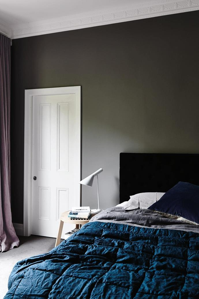 "**Deep sleep** Create a cosy mood with [charcoal walls](https://www.homestolove.com.au/dark-walls-paint-colour-ideas-for-dramatic-effect-18639|target=""_blank"") and [heavy draped curtains](https://www.homestolove.com.au/buyers-guide-to-curtains-16751