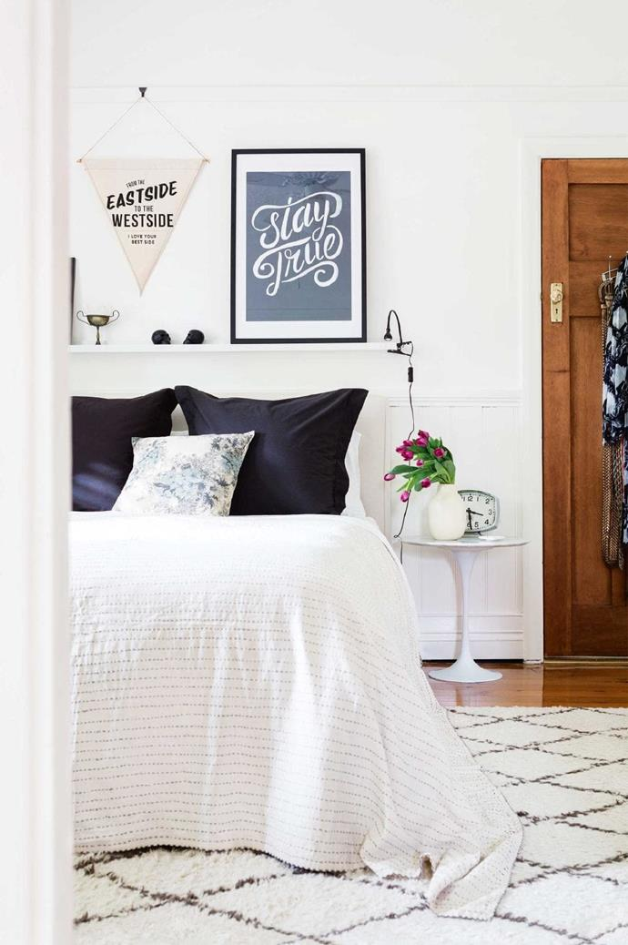 Continuing the success of the monochromatic scheme of the living zone, this space enjoys a more subtle take. Typographic art – a flag from Pony Rider and a Blacklist print – makes a smart finishing touch to the sparse palette.