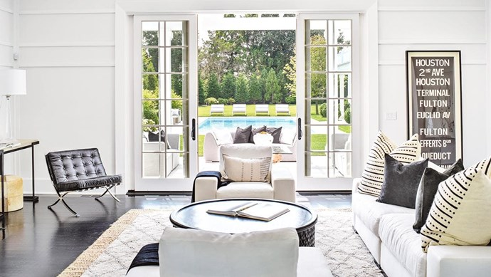 "A variety of relaxation zones will create that chilled-out [Hamptons look](https://www.homestolove.com.au/how-to-get-the-hamptons-look-3523|target=""_blank""). This sitting area steps out to an airy outdoor living space, while a series of sun lounges beckon guests to the pool. Looking for ways to take Hamptons style outdoors? Here are [10 Hamptons style outdoor areas to inspire](https://www.homestolove.com.au/hamptons-style-outdoor-areas-19180