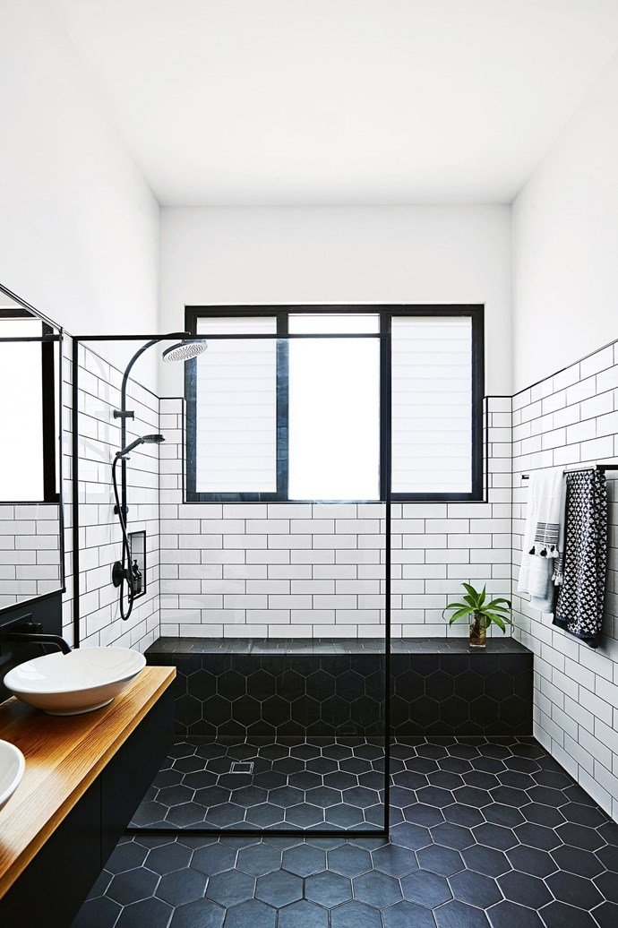 """Black hexagonal tiles add a fun, modern dimension to this otherwise classically styled bathroom in a [dream farmhouse](https://www.homestolove.com.au/a-son-builds-his-parents-their-dream-farmhouse-15678