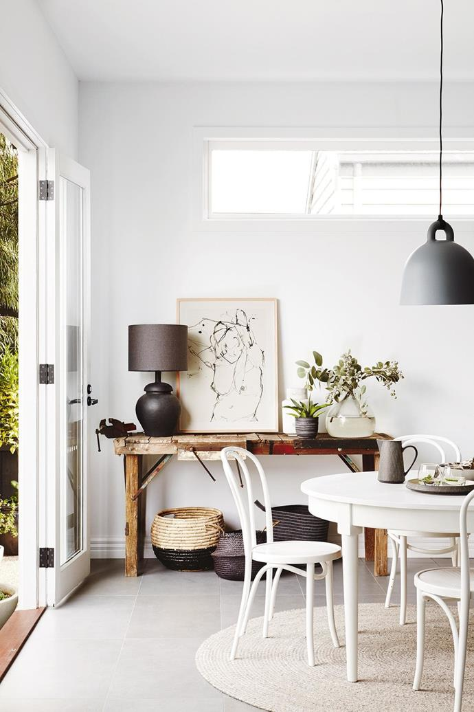 """**Dining area** White Thonet dining chairs from Huset contrast with the raw timber workbench. """"I love a vintage find,"""" says Sal. """"This bench was headed for the tip, but its age and character called my name!"""" Artwork: (opposite) Print by Ali McNabney-Stevens, [Greenhouse interiors](https://greenhouseinteriors.com.au/). [Read the full story here](http://www.insideout.com.au/renovations/house/this-californian-bungalow-in-victoria-was-lovingly-refreshed/news-story/1ff80a7759649bff4db54980b65d85ce). _Styling by Julia Green with assistance by Georgie Fitzgerald and Emily Evans. Photography by Annette O'Brien_."""