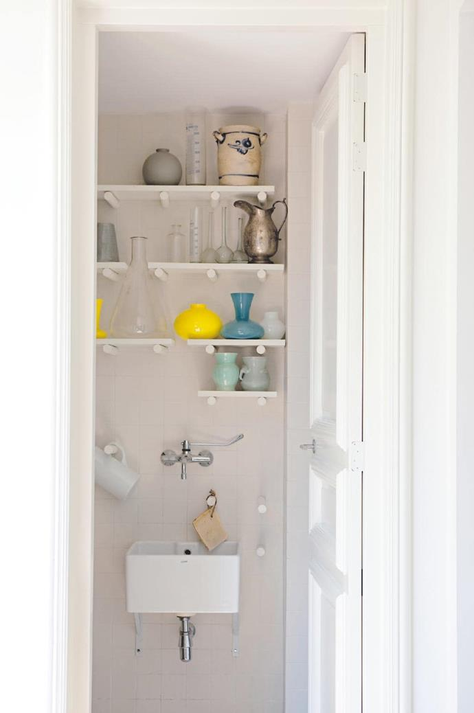 Extra tips: Space-smart storage. Handy poles allow shelves to be moved around in a Tetris-like formation to suit whatever needs to be stored Stylist: Jessica Bouvy, Photographer: Dana Van Leeuwen