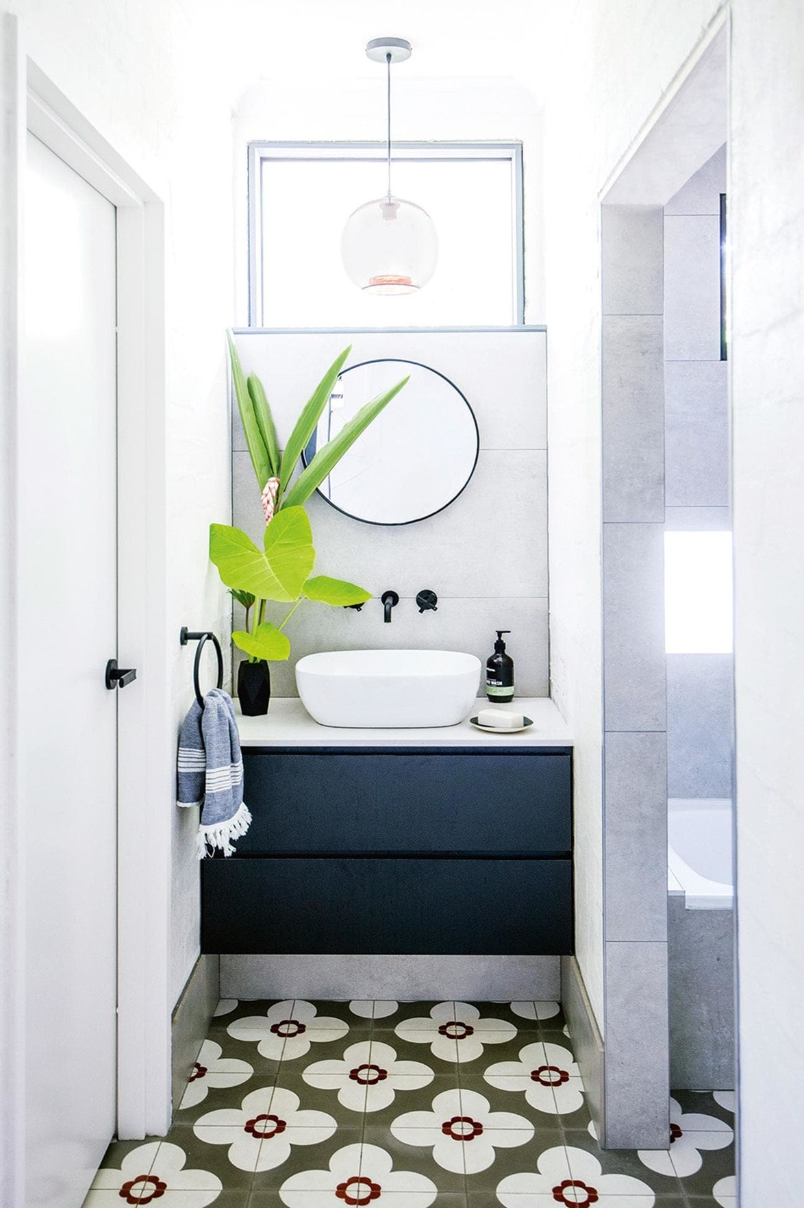 "This wall hung vanity with two deep drawers provides ample storage for this [small bathroom](https://www.homestolove.com.au/small-bathroom-design-ideas-20211|target=""_blank"")."