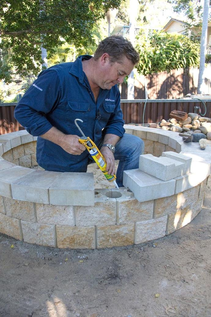 **Step 5: Finish with wall caps** <br> Place AB Courtyard Caps on top of the fire pit, securing them with a tube of masonry adhesive.