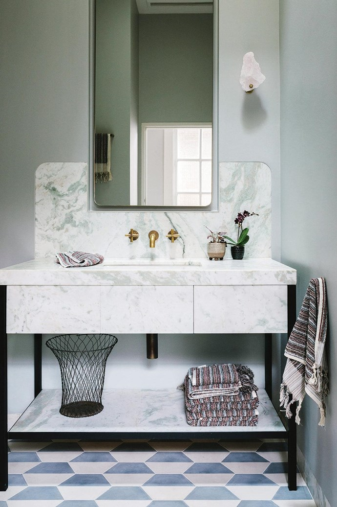 """Foregoing floor-to-ceiling tiles, this [elegant bathroom](https://www.homestolove.com.au/how-to-make-a-small-bathroom-look-elegant-15491