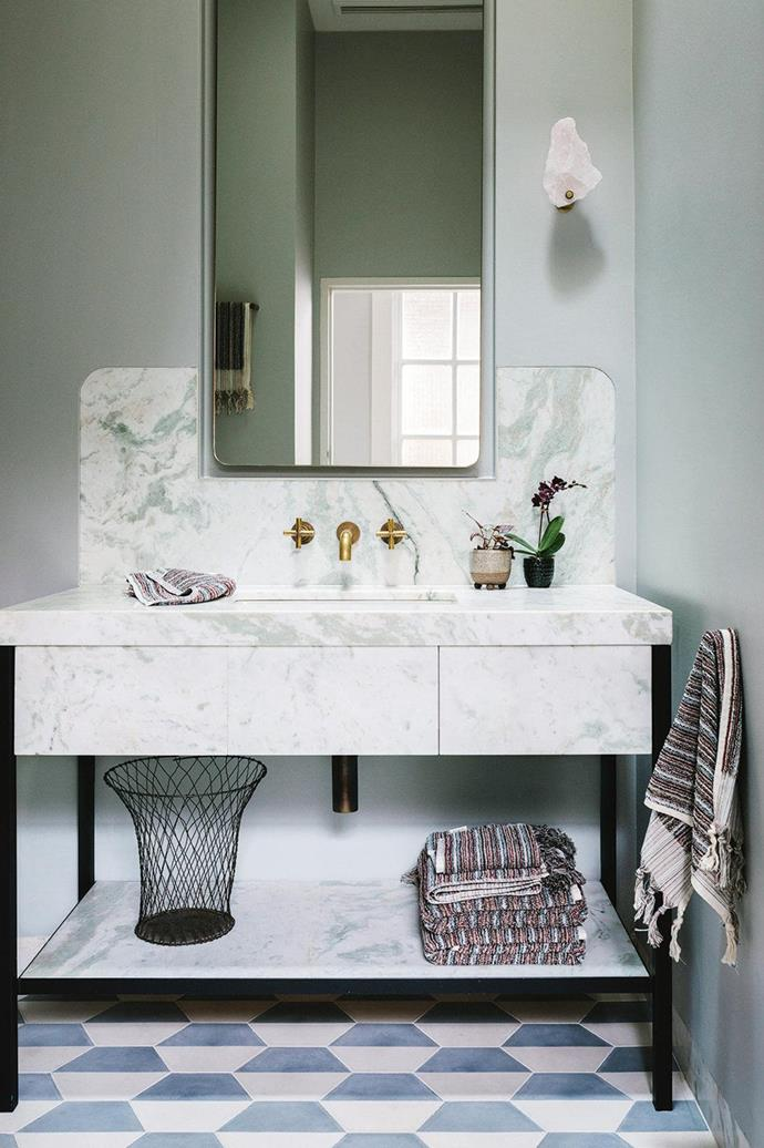 "Foregoing floor-to-ceiling tiles, this [elegant bathroom](https://www.homestolove.com.au/how-to-make-a-small-bathroom-look-elegant-15491|target=""_blank"") features a statement marble vanity and patterned floor tiles."