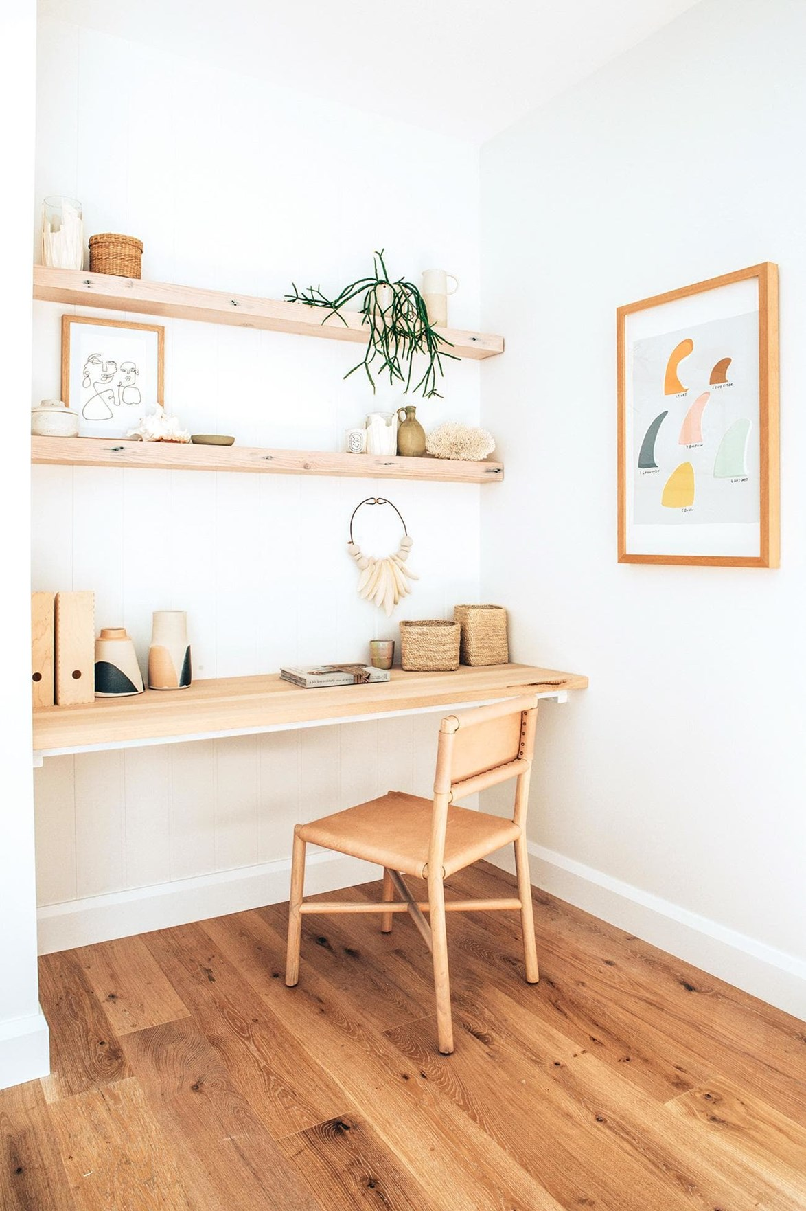 A combination of stylish storage and decorative objects keep Kyal and Kara's home office looking chic and cohesive.