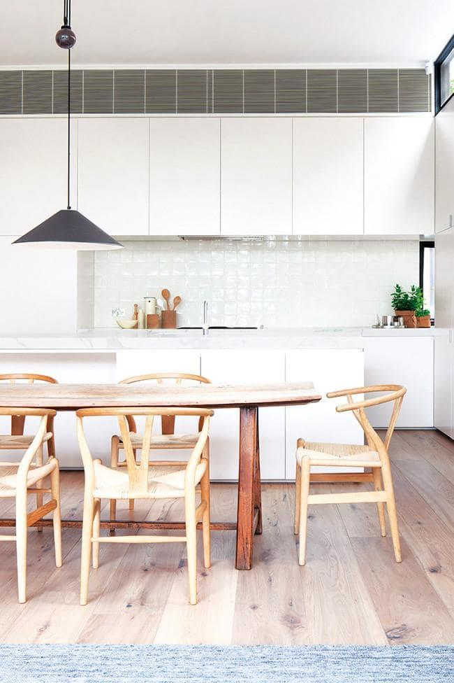 Catching the light from a corner window, the splashback adds a subtle, glossy feature to the understated kitchen Photographer: Shannon McGrath