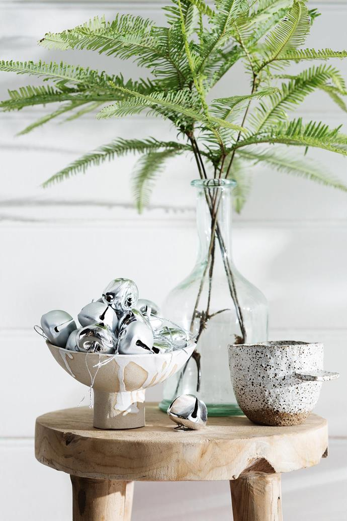 <b>Silver ornaments</b> complement bleach blonde timber and neutral ceramics perfectly. Don't forget to stock up on the fresh greenery!