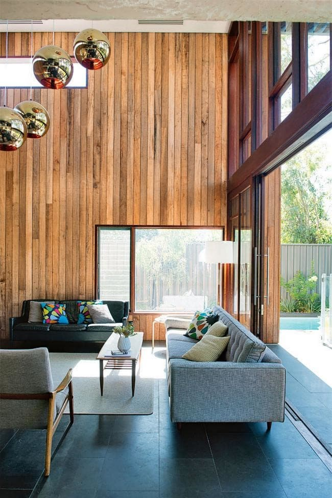 This home's floor-to-ceiling north-facing windows take advantage of the winter sun and links the indoors and outdoors. Bring a warm natural touch with jarrah, louvres and 'Pacific Teak' hardwood timber cladding. Photographer: Jody D'Arcy