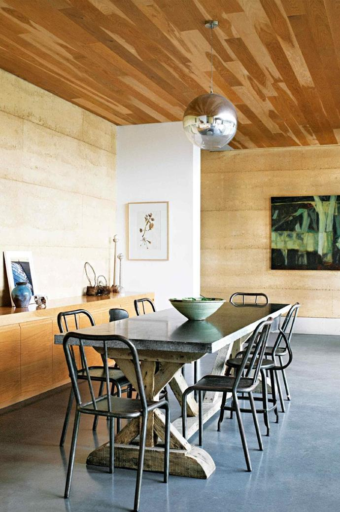 A mix of textures is at play in the dining room. A weighty bluestone slab rests on a French oak table base from [Parterre](http://www.parterre.com.au/), surrounded by [The Country Trader](http://www.thecountrytrader.com.au/) assorted metal chairs Stylist: Karen Cotton, Photographer: Prue Ruscoe