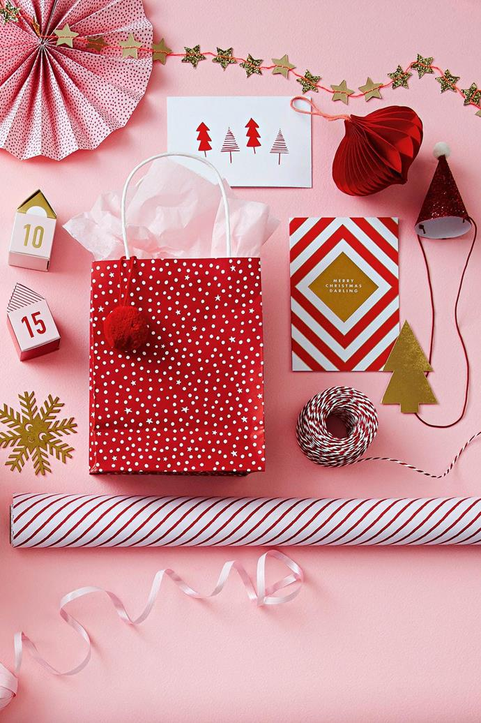 <b>Pink, red &amp; gold</b> Give traditional festive ruby a fresh feel with dusty peony tones, patterns and a touch of luxe glitter.  <b>Products</b> Meri Meri mini star garland, $20, Papier D'Amour. 'Line Trees' card, $7.50, Me And Amber. Pantone 'Onion' honeycomb decoration, $7.50, and Meri Meri mini Santa hat, $25/set of 6, Papier D'Amour. 'Joy' gold tree gift tag, $12.95/assorted pack of 12, Kikki.K. Lagom 'Merry Christmas Darling' card, $6.95, Waterlyn. 'Vinter' red &amp; white twine, $4.99/40m roll, IKEA. Stripe wrapping paper, $9.95/5m roll, Kikki.K. 'M&aring;ngfald' gift ribbon, $2.99/assorted set of 3, IKEA. 'Starry Night' red gift bag, Vandoros. Raine &amp; Humble pom pom, $15.95/set of 6, Paper2. Tissue paper, stylist's own. Studio Arhoj 'Xmas Blink' brushed brass decoration, $120/assorted set of 5, Little Pie Street. Numbered boxes (part of 'Eraser' advent calendar), $29.95, Kikki.K. Background in 'Clean &amp; Protect' low sheen interior paint in Pink Haven, $62.50/4L, British Paints.