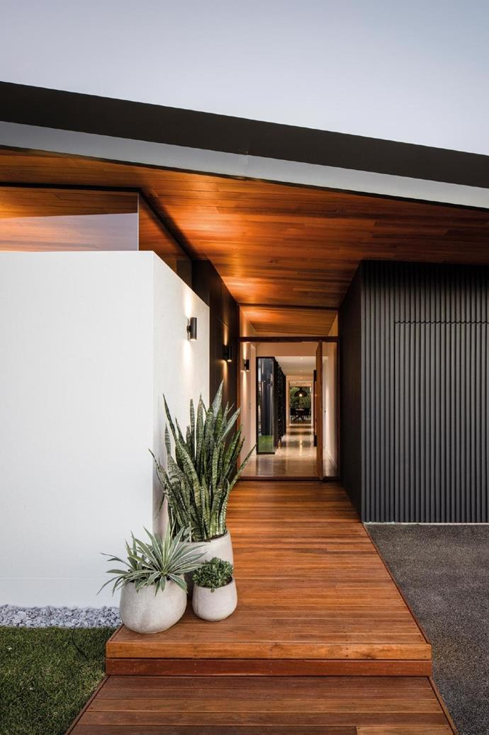 A large rosewood entrance door greets guests in a most inviting manner.