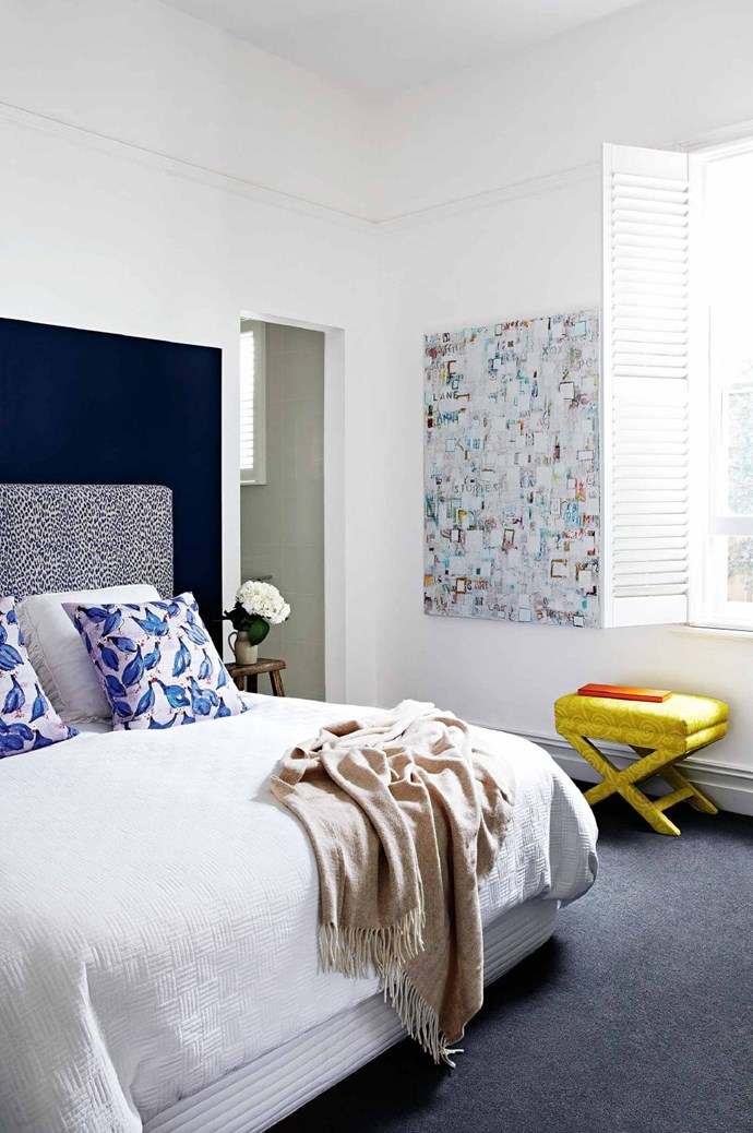 After Will vetoed painting the room in a dark blue, Emma settled for a painted square behind the bed, which frames the existing upholstered headboard Stylist: Heather Nette King, Photographer: Armelle Habib