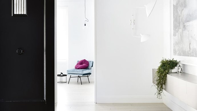 **Entry** Pale timber flooring creates a calming mood. A floating console visually increases floorspace, while the white [Serge Mouille](http://sergemouille.com/) wall light draws attention to the striking [Valerie Sparks](http://valeriesparks.com.au/) artwork. A peek into the master bedroom reveals a plush [Arflex](http://www.arflex.it/) chair Photographer: Derek Swalwell, Stylist: Rachel Vigor