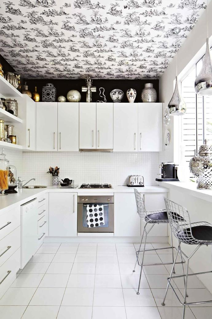 The kitchen packs a stylish punch with the black and white palette providing the perfect backdrop to collectibles Photographer: Armelle Habib, Stylist: Julia Green & Aimee Tarulli
