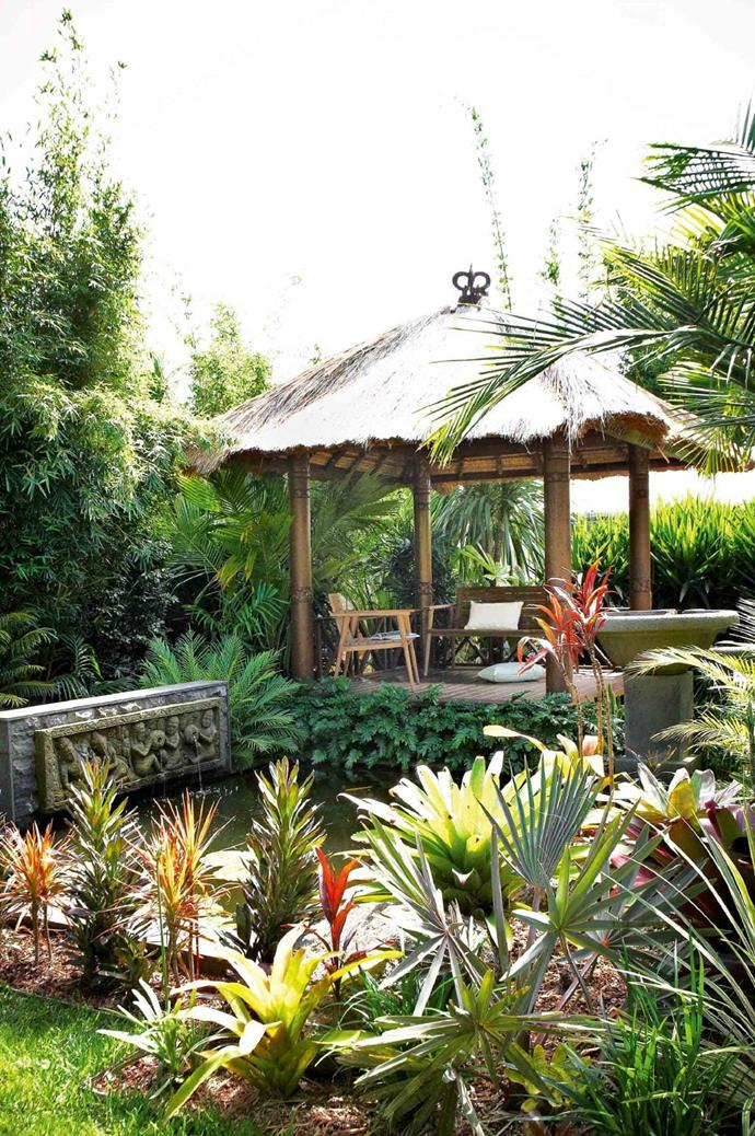 The koi pond is filtered by plants and topped up with solar-powered tank water. Bromeliads, Beccariophoenix madagascariensis, cordyline and a wedding palm fringe the edges Photographer: Michael Wee, Stylist: Phoebe McEvoy